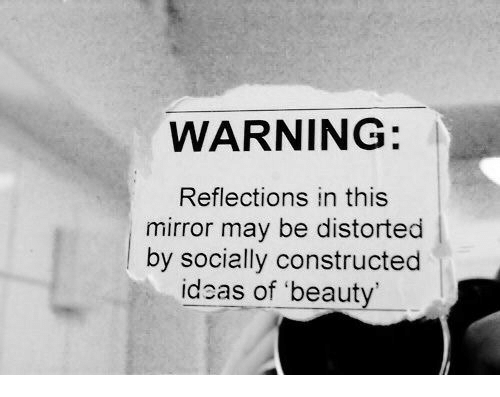 distorted: WARNING:  Reflections in this  mirror may be distorted  |by socially constructed  ideas of 'beauty