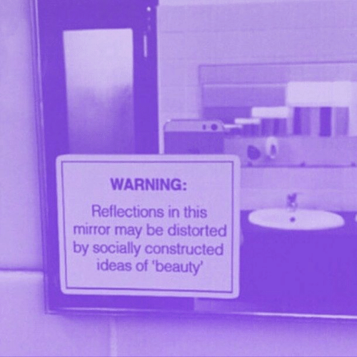 distorted: WARNING:  Reflections in this  mirror may be distorted  by socially constructed  ideas of 'beauty