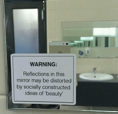 beauty: WARNING:  Reflections in this  mirror may be distorted  by socially constructed  ideas of 'beauty
